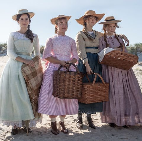 Poster image of the four March girls standing next to each other on a beach with picnic baskets.