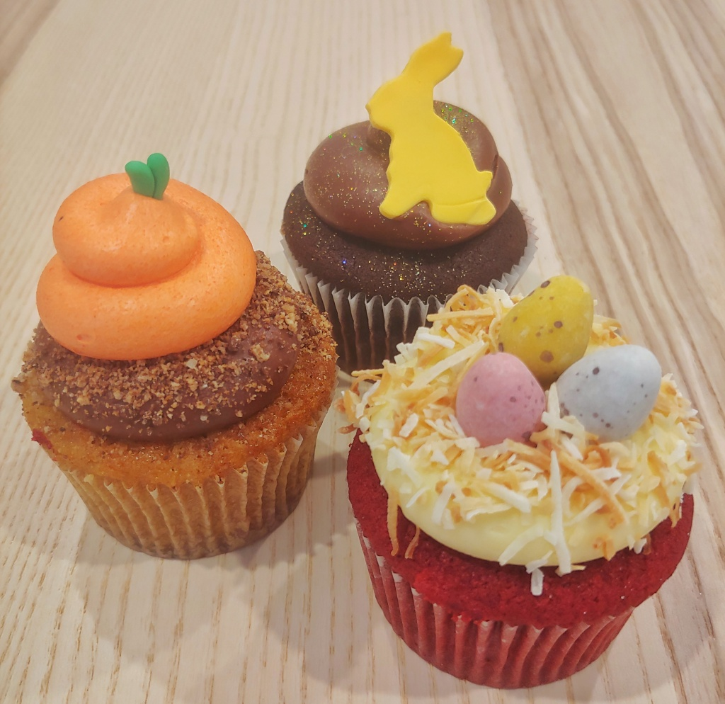 Close-up shot of three Easter themed cupcakes