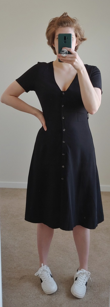 Black dress with short sleeves and small buttons down the front.