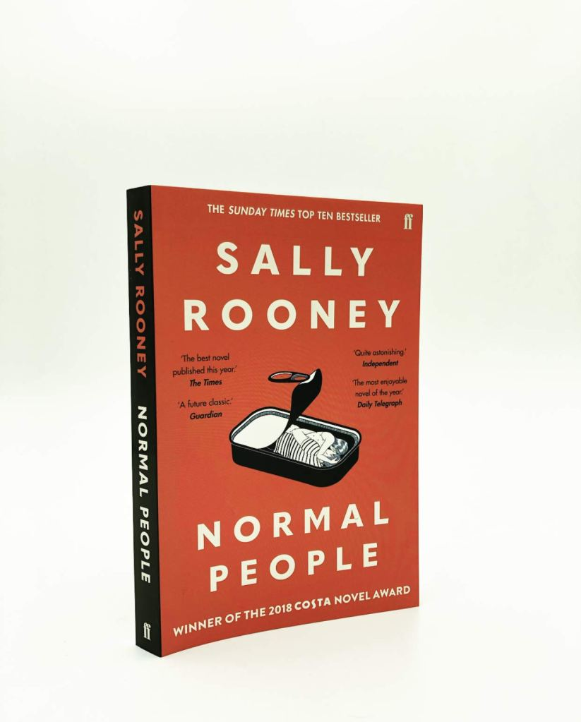 Paperback copy of Normal People, with a black and white drawing of two people curled up in an open sardine tin.
