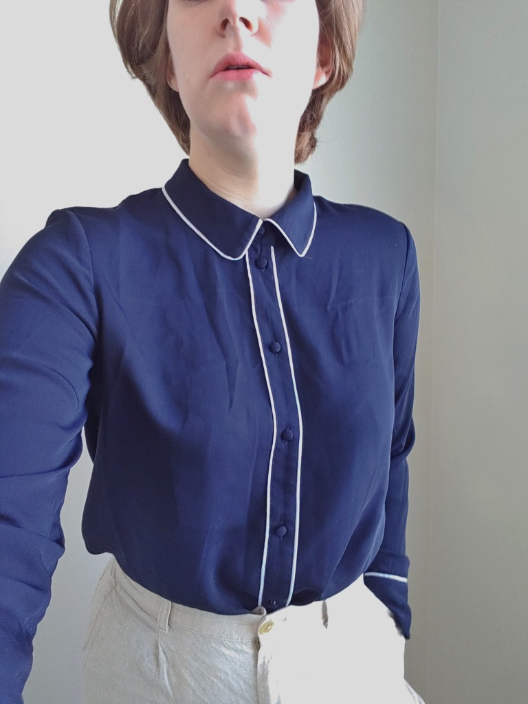 Photo of the long-sleeved shirt buttoned all the way to the top of the collar.