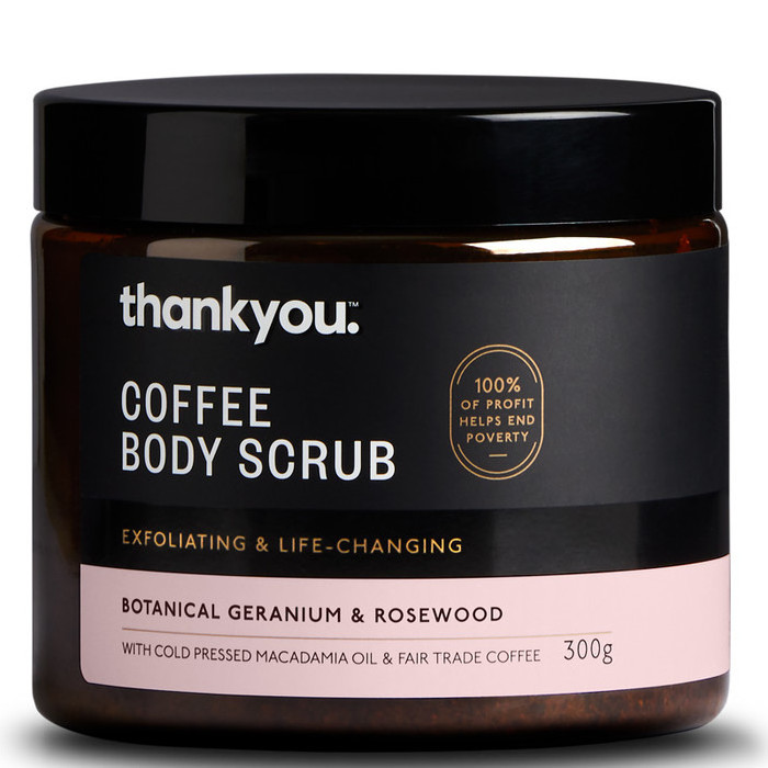 Small tub of Coffee Body Scrub with a black and pink label.