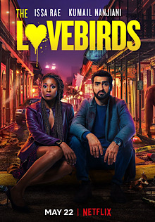 Film poster for The Lovebirds, with Issa Rae and Kumail Nanjiani sa on a street curb with a brightly lit street behind them.